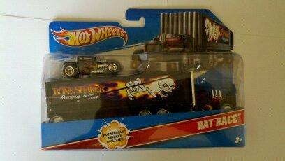 2010 Hot Wheels Rat Race Truckin Transporter wBlack Bone Shaker Combo